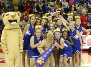 The College Street Elementary cheerleaders celebrate with their trophy after winning the 2015 CCBYL cheer competition