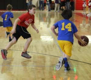 Westwod's Eli McKamey(right) tries to break the New Union full court press of John McKelvie(left) in Saturday's semifinal action of the Coffee County Youth Basketball League tournament