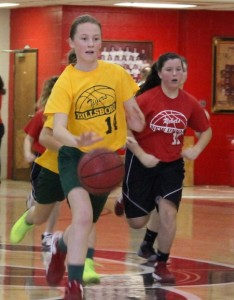 Hillsboro's Marley Perry(left) on the fast break as New Union's Riley Tucker(right) gives chase in Saturday's semifinal action of the Coffee County Youth Basketball League tournament