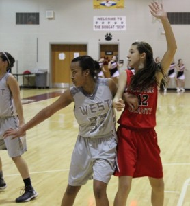 CCMS post player Lindsey Perry(right) fights for position against  West Tullahoma on Thursday