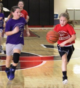 New Union and Deerfield girls battle in Saturday's elementary tournament.  New Union won by a score of 27 to 12