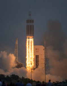 The United Launch Alliance Delta IV Heavy rocket, with NASA's Orion spacecraft mounted atop, lifts off from Cape Canaveral Air Force Station's Space Launch Complex 37 at 7:05 a.m. EST, Dec. 5, in Florida. AEDC test teams supported Exploration Flight Test-1 by assisting in testing several key components for the aircraft. (Photo by Bill Ingalls, NASA)