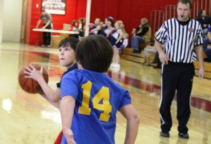 Westwood and East Coffee battle in elementary tournament action on Saturday.  Westwood won by a final score of 37 to 8