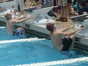 Daniel Larsen (red cap) fires off the blocks at state championship... Photo provided