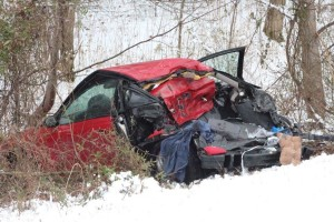 Red Saturn involved in deadly crash... Photos by Barry West
