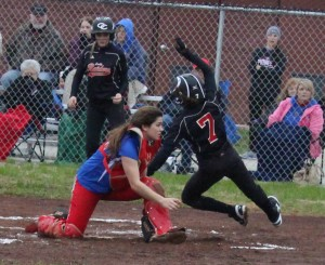 Ashley Evans(#7) dives around the Warren County to score a run for Coffee County on Thursday night as Sierra Mahar, who scored ahead of Evans, looks on in the background