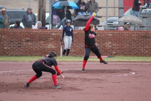 Brianna Jones fires a pitch in the rain during Monday's not-hit performance... Photo by Barry West