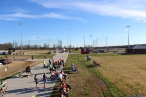 The opening day crowd for spring sports at the Coffee County Middle School on Monday.  Soccer fans(foreground) take in the soccer match while the baseball field(back left) and softball field(back right) prepare to get their games underway.