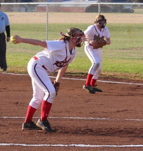 CCMS pitcher Haley Richardson(foreground) winds up to throw a pitch against Harris on Monday as first baseman Keelie Hillis gets ready on defense(background.