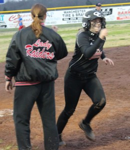 Haley Richardson(right) of Coffee County smiles after getting a celebratory high five from CCMS head coach Lana Creek following her walk-off home run on Thursday night against Warren County