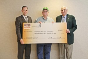 Johnny DeBerry (center) receives the check he donated... Photo provided