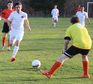 CHS forward Samuel Brown(left) attempts to get a shot off against the MTCS keeper in JV action on Monday night.