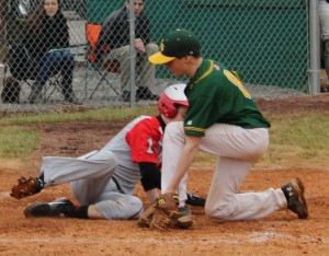 CCMS centerfielder Trace Bryant slides in safe on a passed ball on Sunday against Whitworth Buchanan