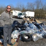 Wayne Limbaugh standing beside garbage that has been picked up… Photo provided