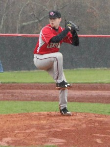 Zach Duncan delivers a pitch in the rain on Saturday