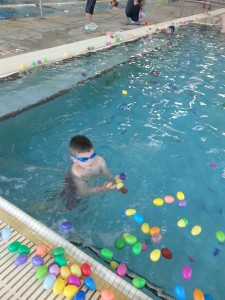 Kids were having fun hunting eggs underwater on Saturday at the Manchester Rec. Center... Photo by Tiffany Clutter