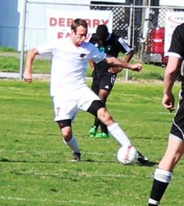 CHS senior midfielder Cole Hawkins dribbles a ball in recent soccer action.