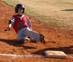 Gage Edwards slides safely into 3rd base during Coffee County Middle School's game on Saturday against Boyd Christian