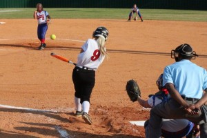 Brittany Williams singles and then scores the only run of the game... Photo by Barry West