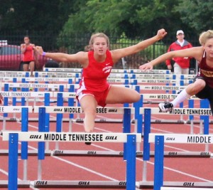 Taylor DeBerry clears the 5th hurdle in Thursday's 100M hurdle race at the TSSAA state track meet