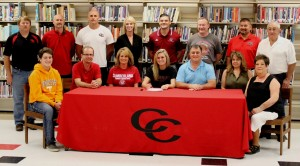 Sara Brown signs her college scholarship with Cumberland University surrounded by family and coaches.  Pictured are: Front Row (left to right) - Blanton Brown(brother), Ronnie Gunter(step father), Christie Gunter(mother), Brown, Brian Brown(father), Judi Brown(step mother), Faye Brown(grandmother).  Back Row (left to right) - CHS assistant coach Andrew Taylor, CCMS head coach Rece Chumley, CHS assistant coach George Pearson, CHS assistant coach Kandi Shemwell, Cumberland University head coach Jeremy Lewis, CHS head coach Herb Horton, CHS athletic director Richard Skipper and Buford Brown(grandfather)