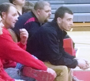 CHS Wrestling coaches (left to right) Kyle Kriz, Roger Barlow and Randall Jennings look on during action last season