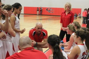 Coach George Pearson talks to his team during a timeout in the conference tournament last week.