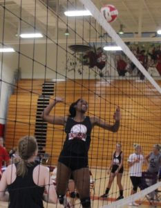 Senior Aerial Williams goes up for a spike on Tuesday for the Lady Raider volleyball team.