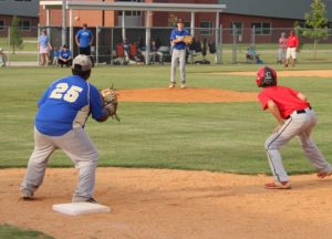 Griffin Meeker gets a lead at 1st base on Friday in a scrimmage with Harris