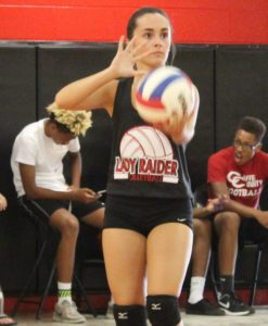 Senior Rachel Henley prepares to serve on Tuesday for the Lady Raider volleyball team.