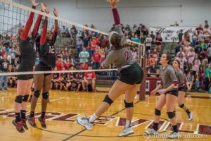 Bailey Morgan(far left) and Aliyah Williams go up for a block against Eaglevile on Wednesday (photo by John StClair - JohnStClairPhoto.com)