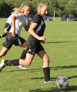 Maddy Jones(in black) of CCMS dribbles the ball past a Tullahoma defender on Monday night.