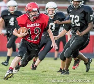CCMS running back Marshall Haney(#12 in red) (Photo by John StClair - www.JohnStClairPhoto.com