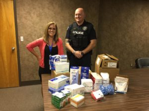 Pictured is Kristen Fox, Unity Medical Center and Officer Daniel Ray, SWAT team leader, MPD.