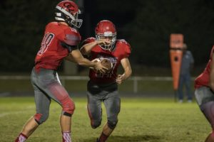 Byron Sullivan(right) takes the handoff from QB Colton Prater(left) during Friday night's game with Oakland[Photo by John St.Clair - JohnStClairPhoto.com]