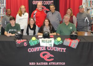 Haley Hinshaw signs with Motlow State Community at a ceremony at CHS on Tuesday. Pictured are: Front Row, left to right - Harley Hinshaw, brother; Anita Hinshaw, mother; Haley Hinshaw; Jeff Hinshaw, father; Back Row, left to right - Lenora Word, Comets softball coach; Janice Morey, Motlow softball coach; Steve Wilder, Coffee County softball coach; Terry Floyd, retired Coffee County softball coach; Erin Stubblefield, former Coffee County softball coach and Jason Conn, Comets softball coach