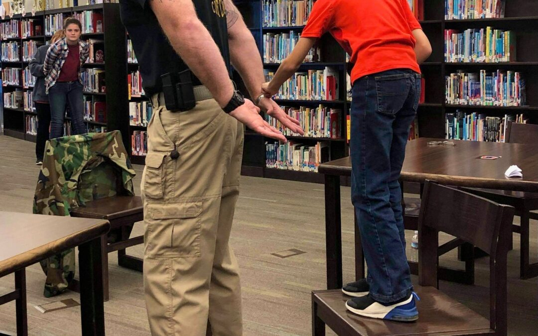 Coffee County Explorers learn handcuff, radio techniques with sheriff's department
